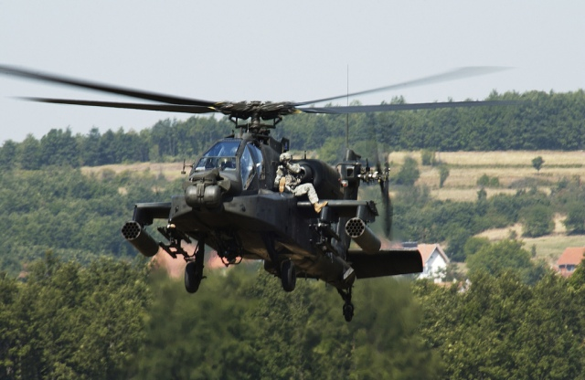 a-multi-national-task-force-east-soldier-rides-shotgun-on-an-ah-64-apache-during-an-apache-extraction-exercise-aug-25-at-camp-bondsteel-kosovo.jpg