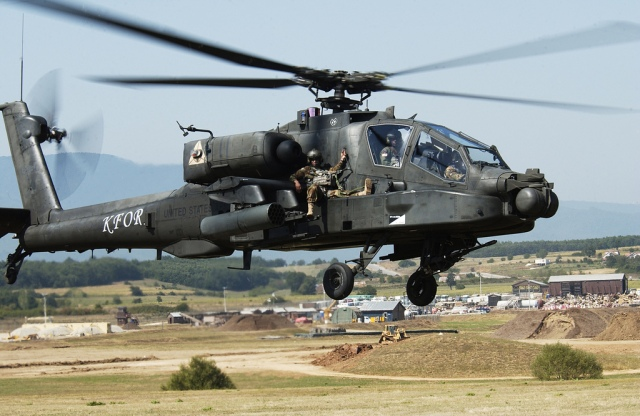 capt-sean-spence-the-commander-of-b-co-tf-eagle-rides-shotgun-on-an-ah-64-apache-during-an-apache-extraction-exercise-aug-25-at-camp-bondsteel-kosovo.jpg