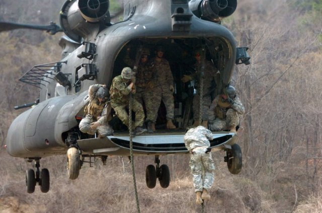 ... Special Forces fast-roping onto land ...